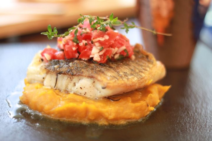 grilled snapper served with a salty, tangy salsa, colourful pumpkin puree and crisp, sautéed vegetables